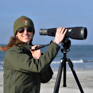 Ranger Amy on the lookout with telescope on Cape Hatteras National Seashore