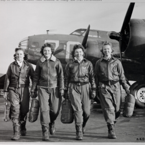 Four Women Airforce Service Pilots in front of airplane during World War II
