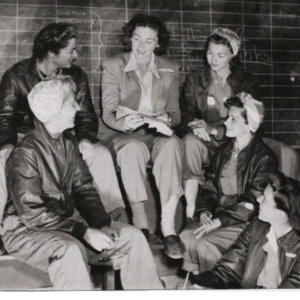 Six Women Air Force Service Pilots (WASPs) sitting in a group talking.
