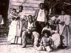 A 19th century black and white photograph of a family living in the Freedmen's Colony on Roanoke Island. The portrait includes two men, two women and four children.