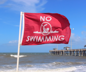 Red No Swimming Flag on Beach