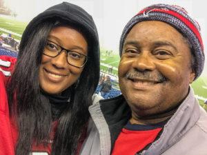 Rebekah and her dad at an Atlanta Falcons football game.